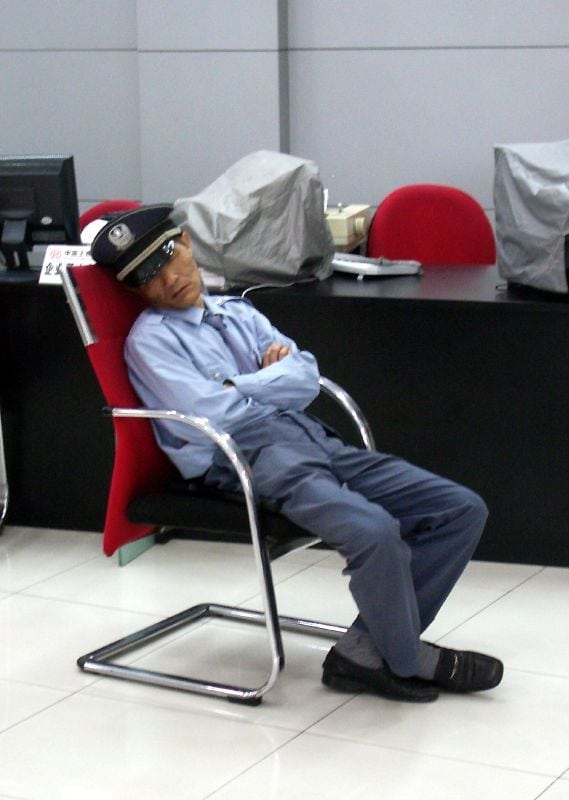 """Bank-Security-Guard-Sleeping"". Licensed under CC BY 2.0 via Wikimedia Commons - https://commons.wikimedia.org/wiki/File:Bank-Security-Guard-Sleeping.jpeg#/media/File:Bank-Security-Guard-Sleeping.jpeg"