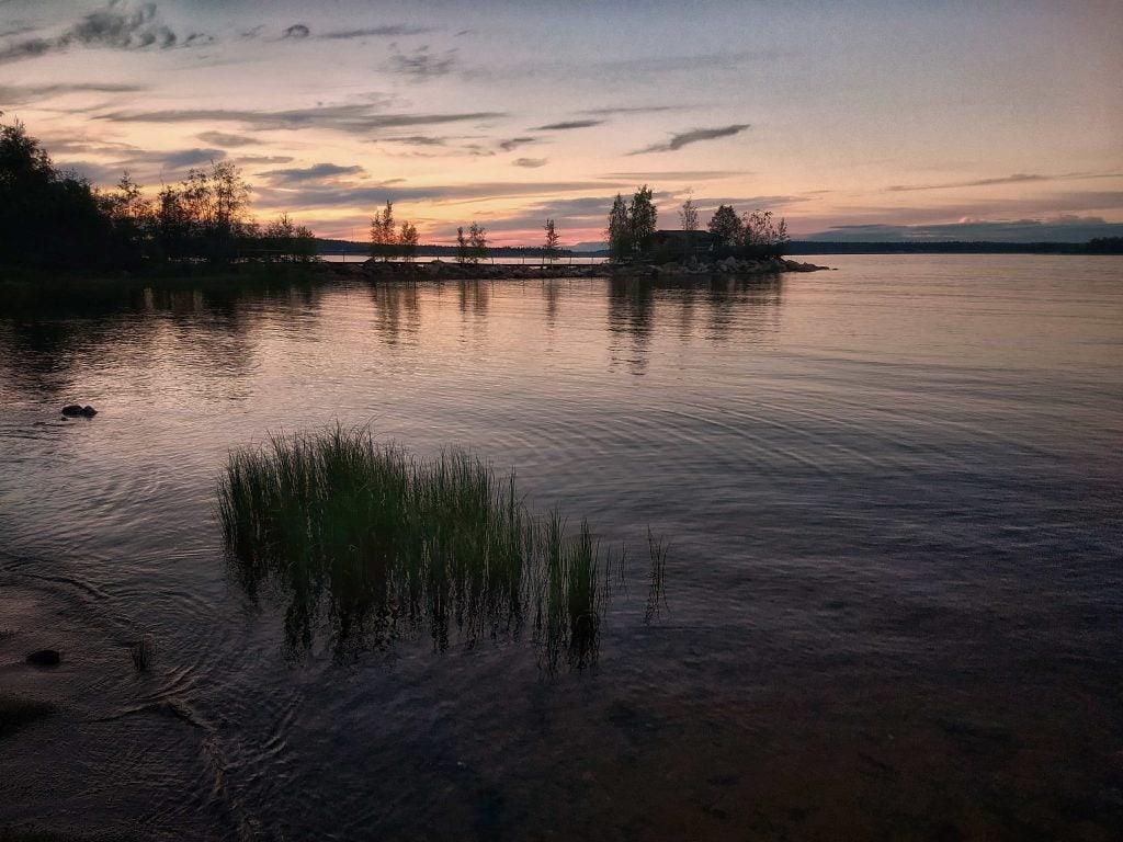 Solnedgång från Jävebodarnas Fiskecamp - Ludwig Sörmlind